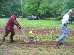 Granddaddy and Uncle Ed with the Seed Planter